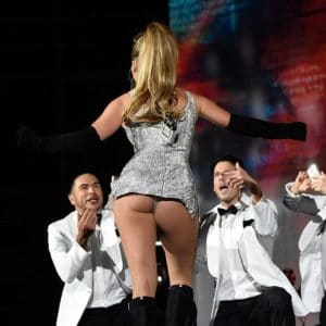 Jennifer Lopez ass hanging out of her silver dress during a concert