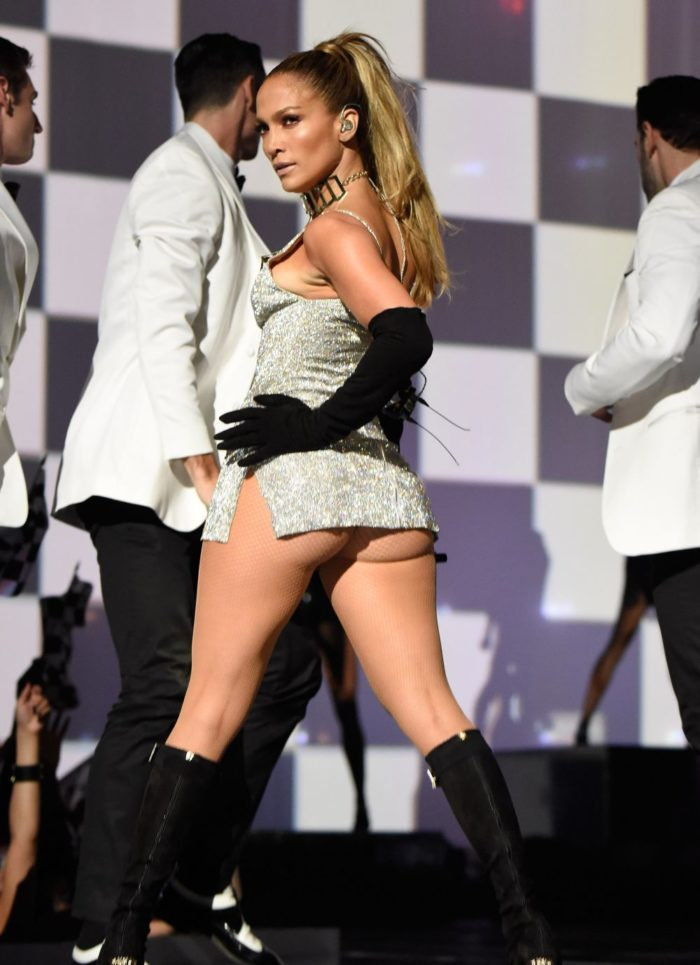 Jennifer Lopez shows her cheeks in sparkly dress while performing on stage