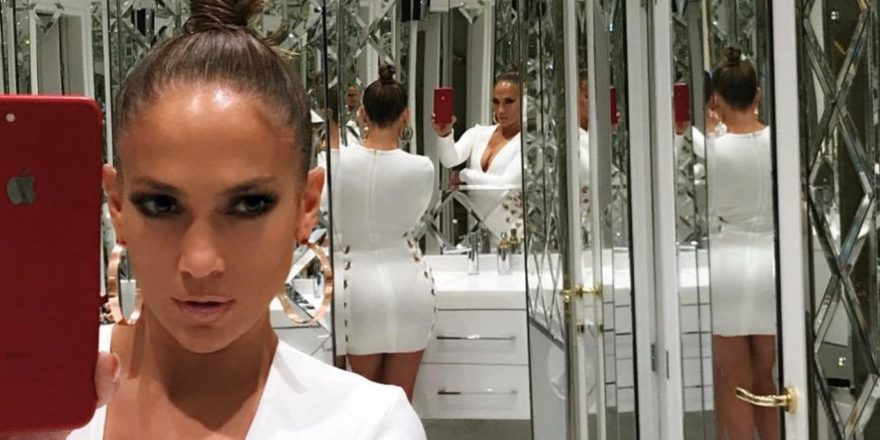Jennifer Lopez taking a selfie in a room of mirrors