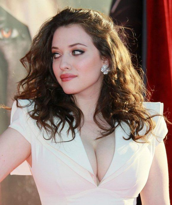 Kat Dennings in a white dress showing off her cleavage