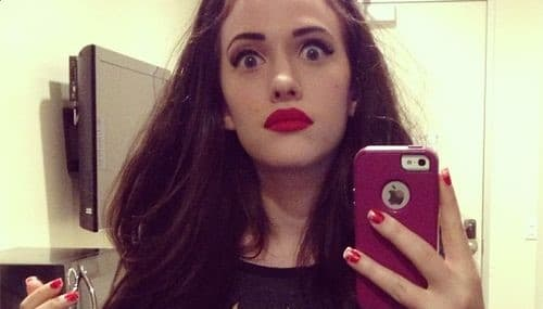 Kat Dennings with red lips selfie