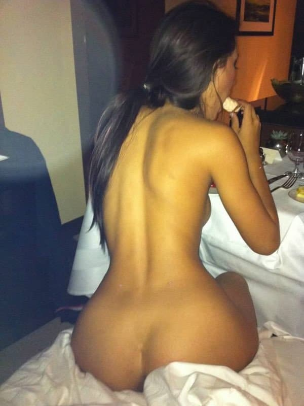 Kim Kardashian totally nude sitting on bed sheets