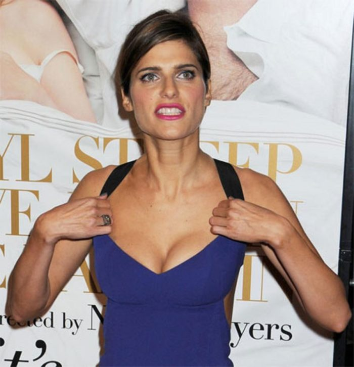 Lake Bell in blue dress with ample cleavage