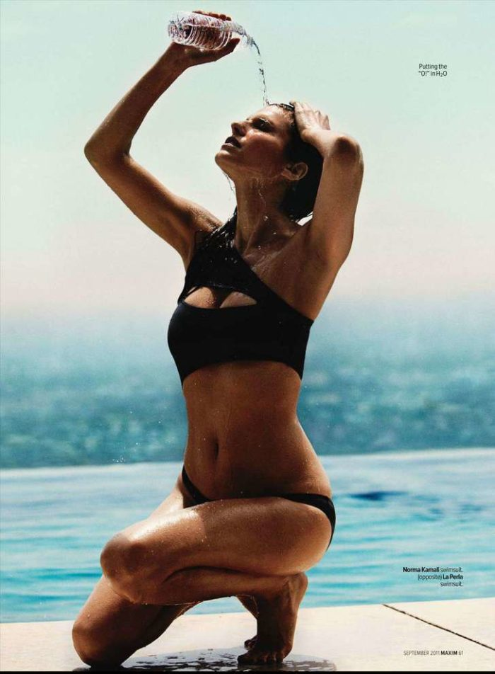 Lake Bell pouring water on herself in Maxim magazine