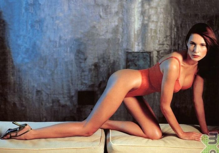 Melania Trump on all fours in a red swimsuit