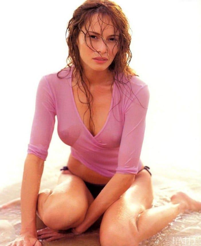 Melania Trump on the beach in a pink shirt nipples peaking through