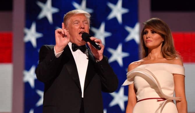 FLOTUS standing next to husband during his speech