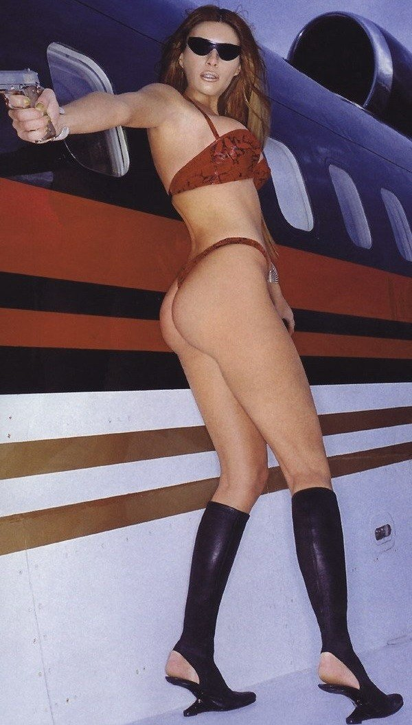 Melania Trump wearing a red swimsuit that expose ass holding a gun