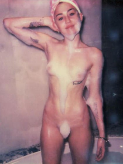 Miley Cyrus totally in the nude covered in suds