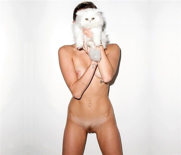 Miley Cyrus totally naked with cat in front of face