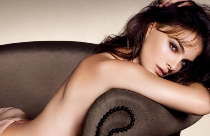 Natalie Portman topless on couch modeling