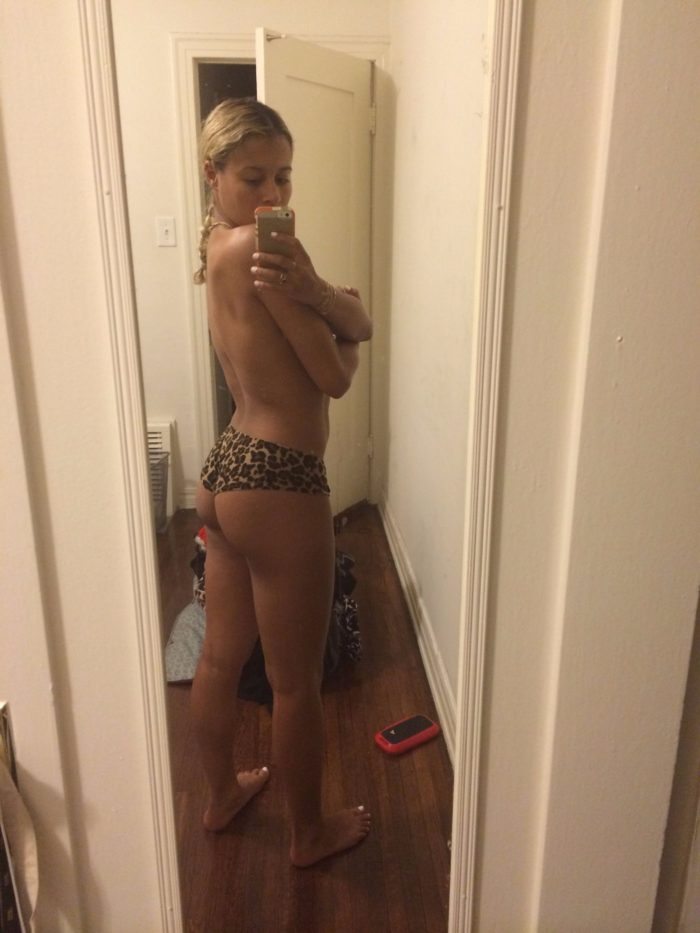 Sami Miro taking a toples mirror selfie