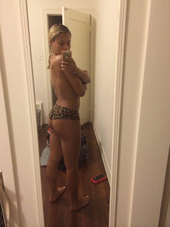 Sami Miro taking a toples mirror selfie