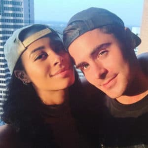 Sami Miro wearing a backwards baseball hat next to Zac Efron