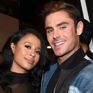 Sami Miro wearing black top hugging Zac Efron