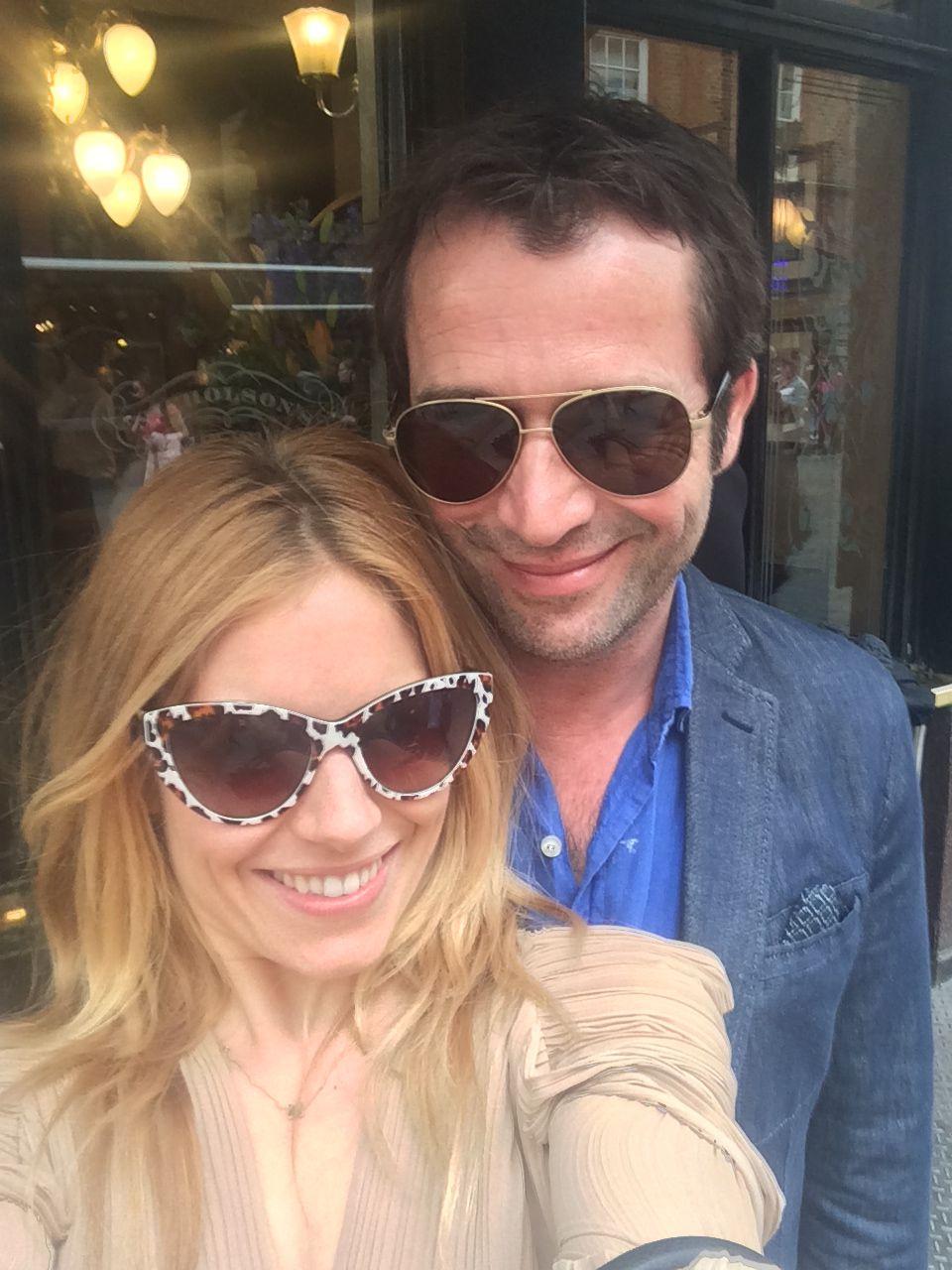 Sienna Miller and boyfriend take selfie infront of store