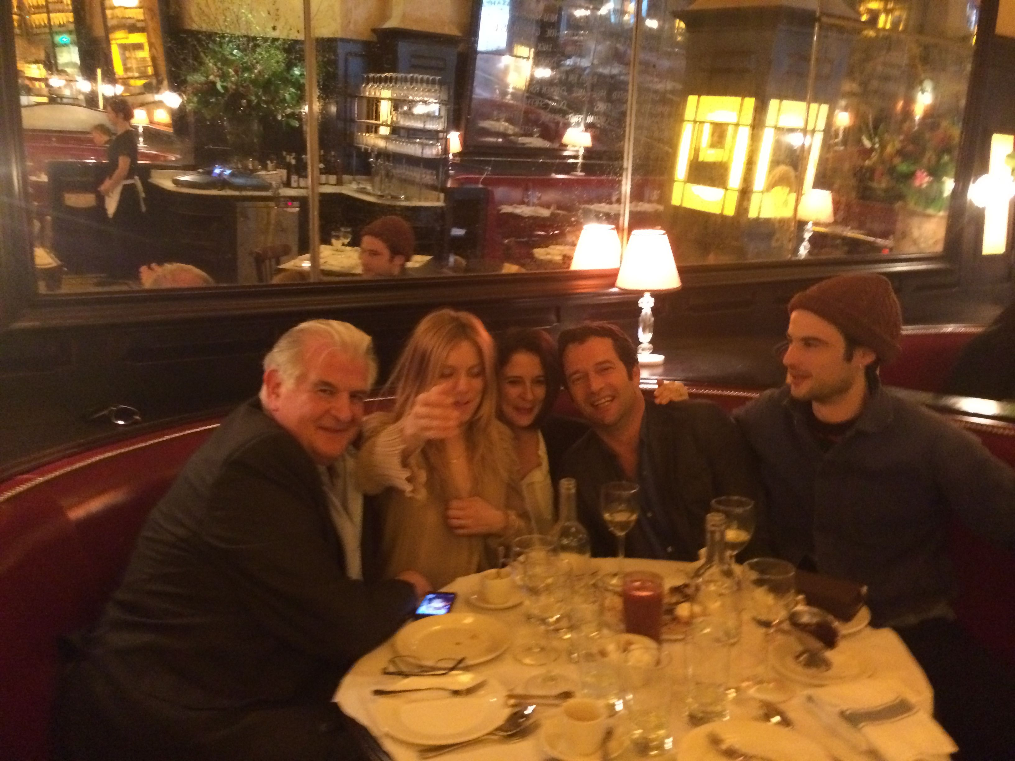 Sienna Miller and friends sitting in booth