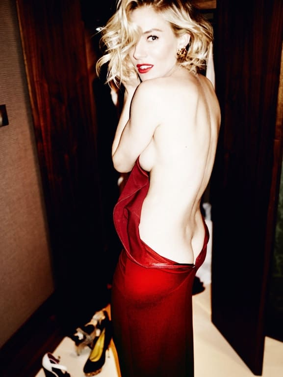 Sienna Miller half naked in a red dress showing her backside