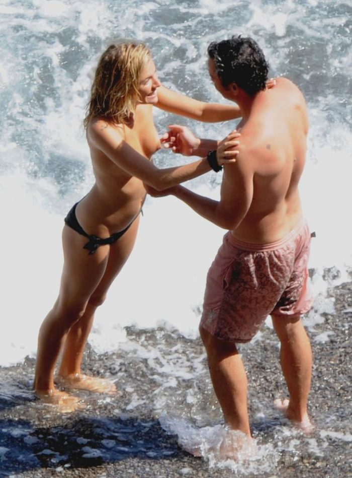 Sienna Miller in the ocean topless and her man grabbing her tits