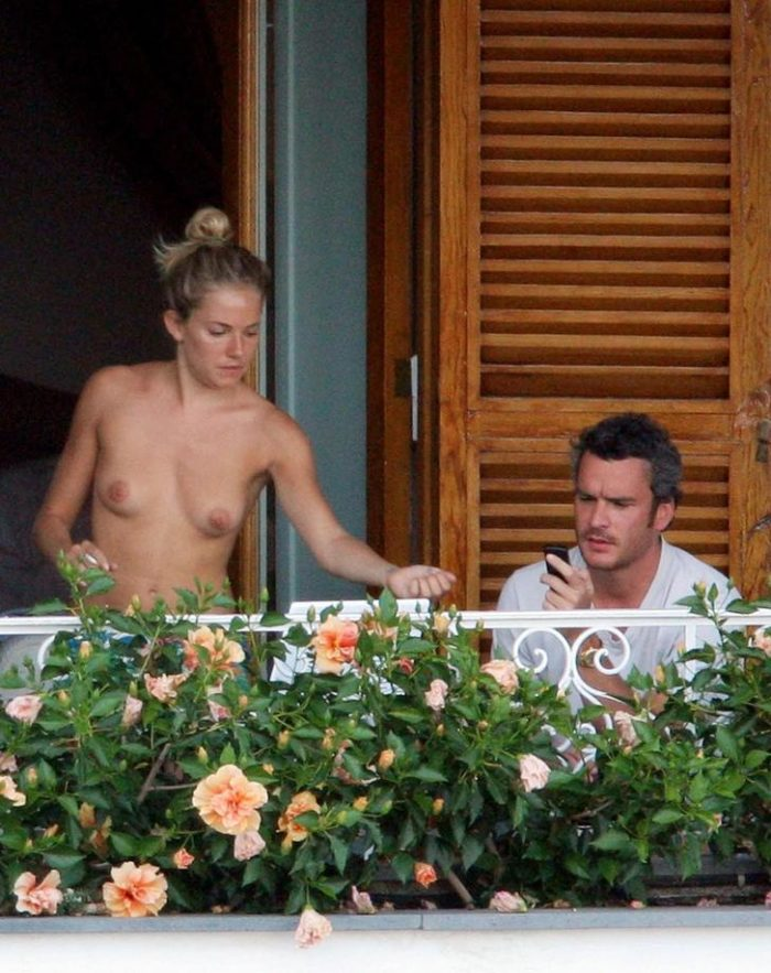 Sienna Miller on a balcony with no shirt on