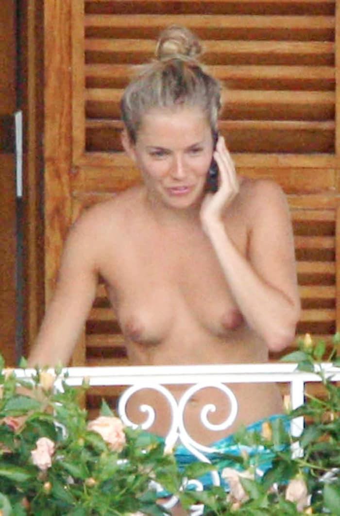 Sienna Miller talking on the phone without a shirt on