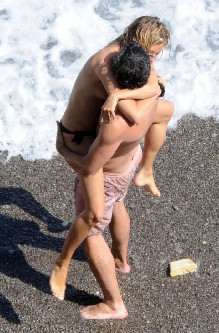 Sienna Miller topless getting picked up by a man at the beach