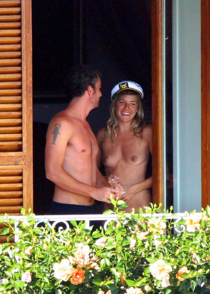 Sienna Miller with a captain hat on showing her breasts