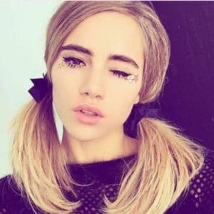 Suki Waterhouse selfie with pig tails and winking