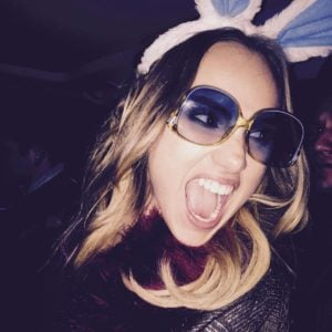 Suki Waterhouse with mouth open and bunny ears
