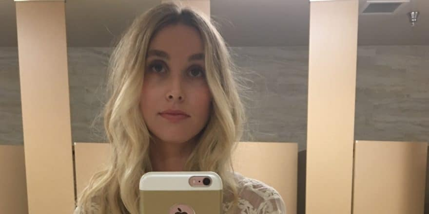 Whitney Port taking a bathroom selfie in airport