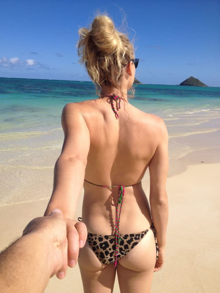 Yvonne Strahovski backside walking on the beach holding someones hand