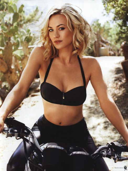 Yvonne Strahovski in a black bra riding a motorcycle