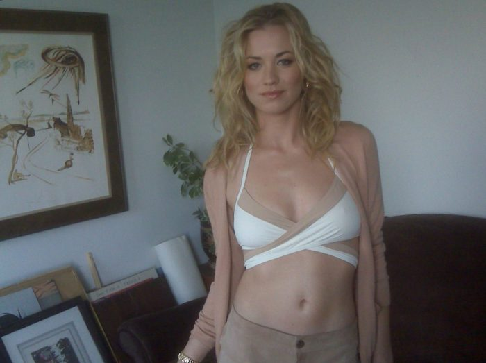 Yvonne Strahovski in a white top exposing cleavage