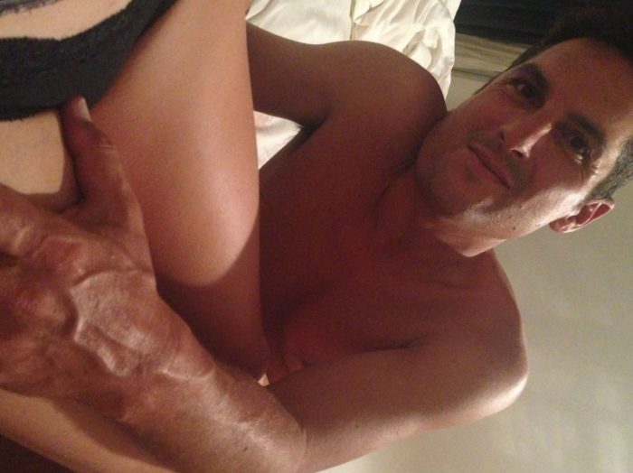 Yvonne Strahovski leg being rubbed by a man