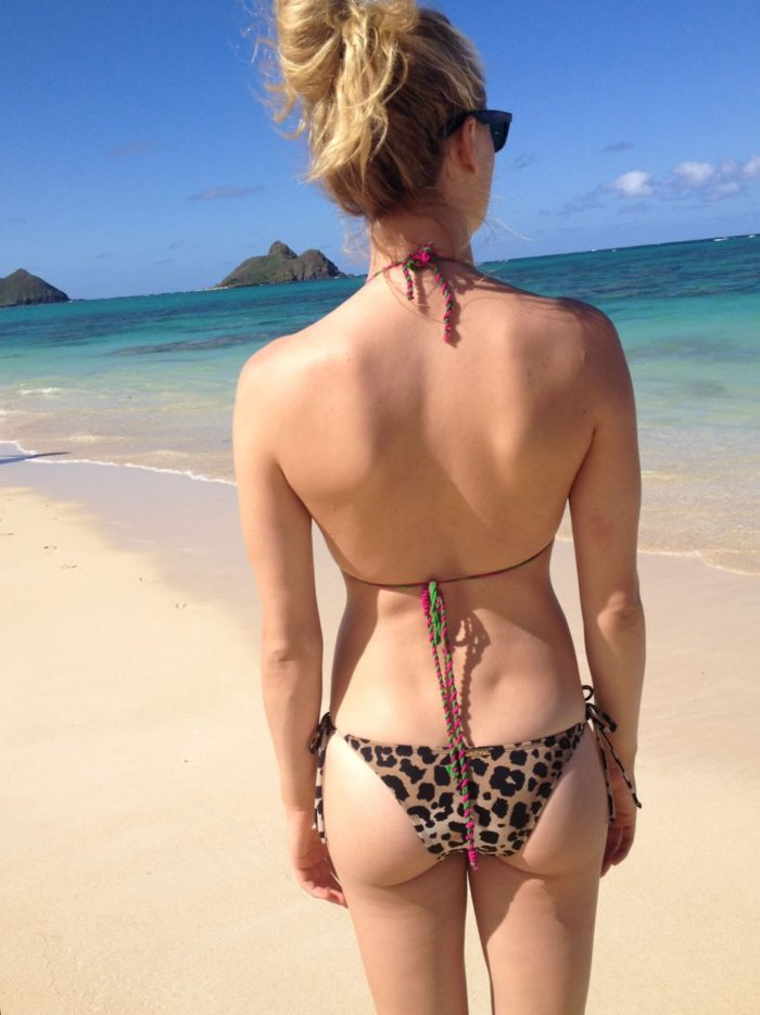 Yvonne Strahovski standing on the beach ass cheeks visivble