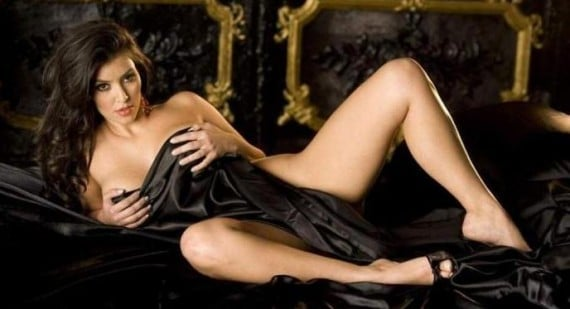 2010 photo of Kim Kardashian laying down with black sheet over her nude body