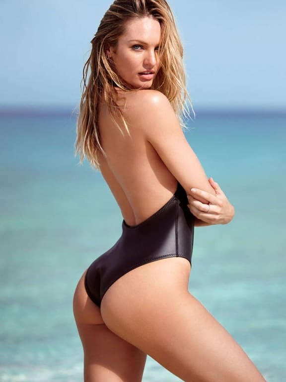 Candice Swanepoel bare butt cheeks in black one piece suit