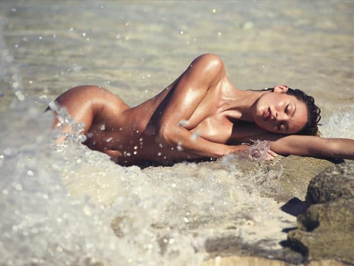 Candice Swanepoel bare in the ocean