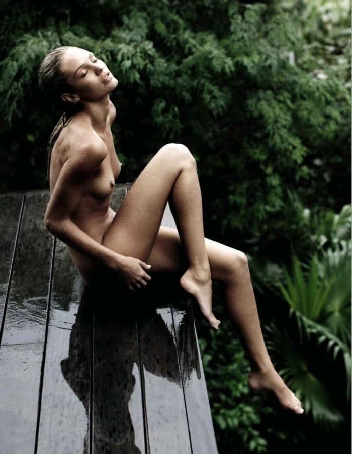 Candice Swanepoel in the rain naked sitting on a deck