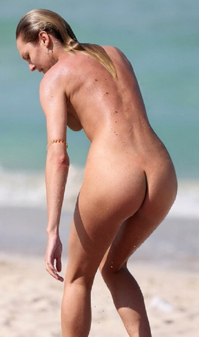 Candice Swanepoel on the beach completely unclothed about to sit down