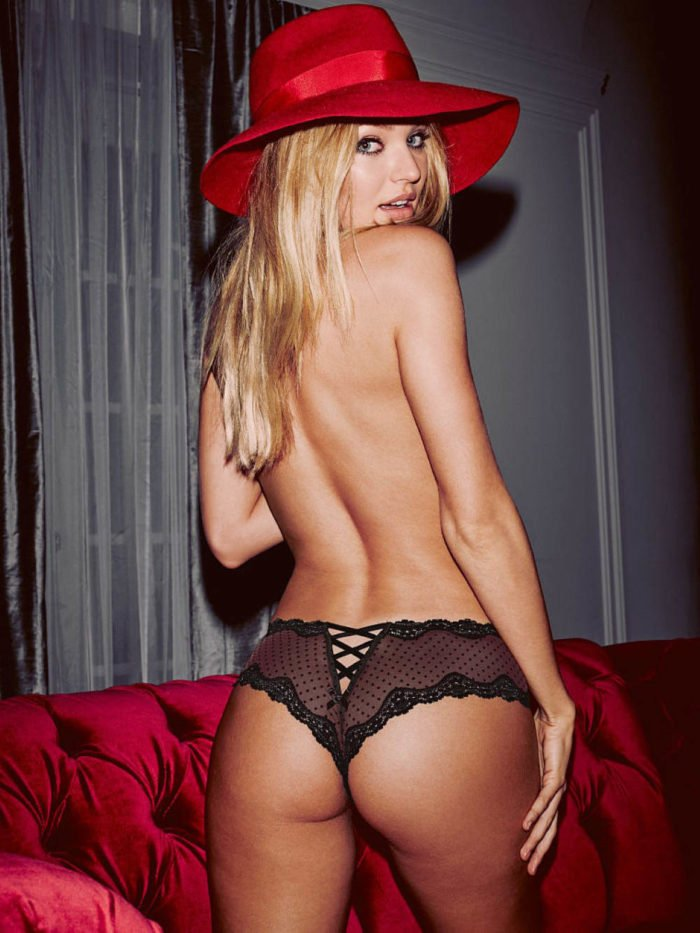 Candice Swanepoel topless with a red hat on and showing off her butt cheeks