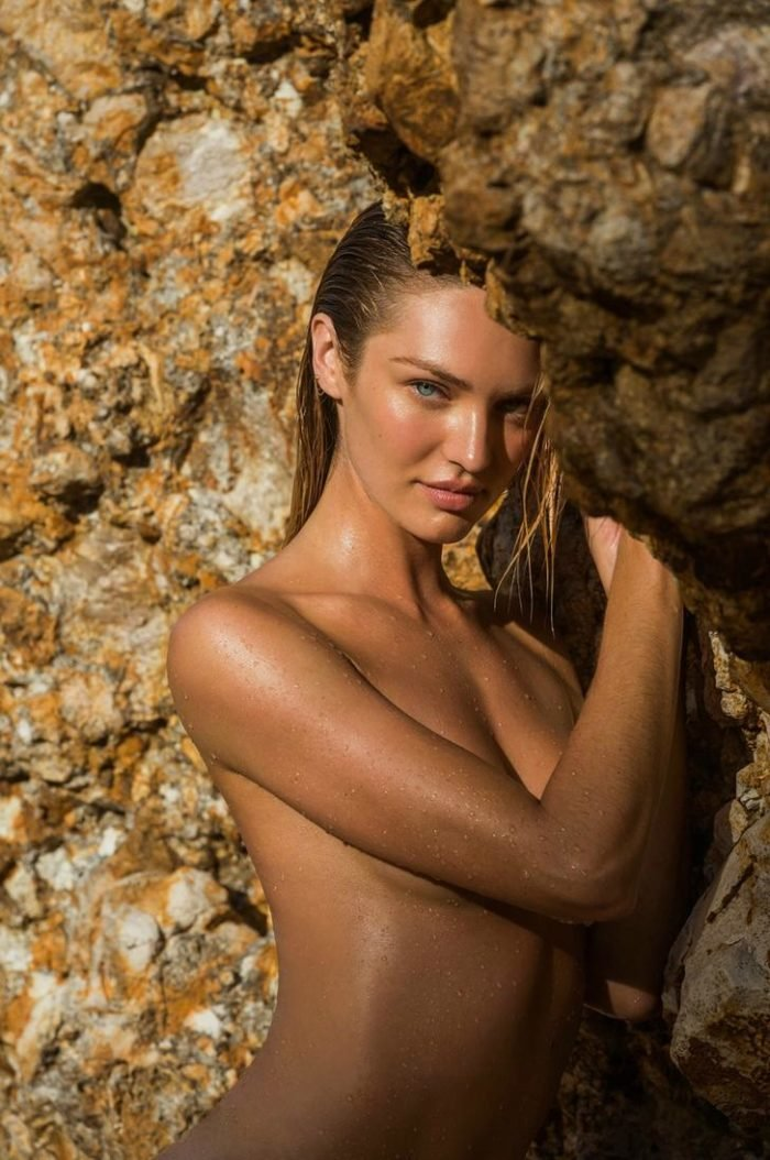 Candice Swanepoel topless with wet hair looking seductively at the camera