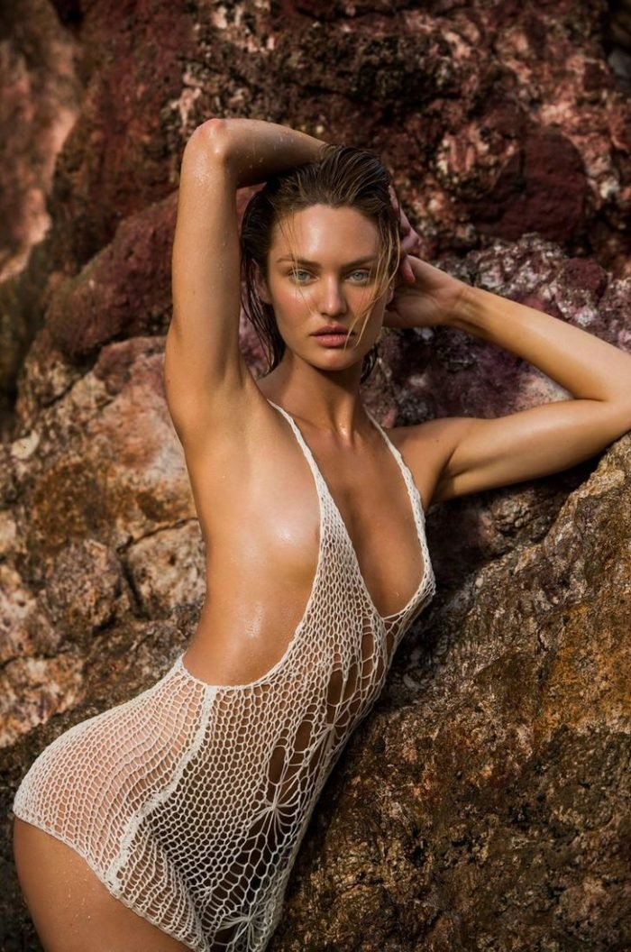 Candice Swanepoel with wet hair and nipples showing through a see through shirt