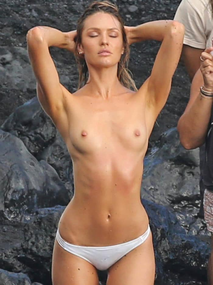 Candice Swanepoel's tits exposed and wearking white bikini bottom