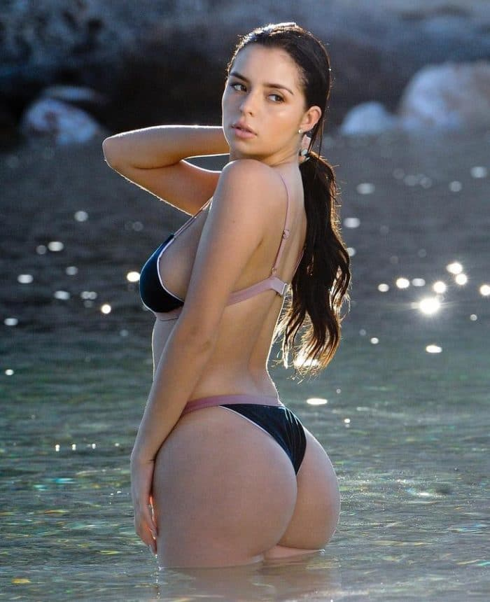 Demi Rose Mawby modeling holding her hair back into a ponytail