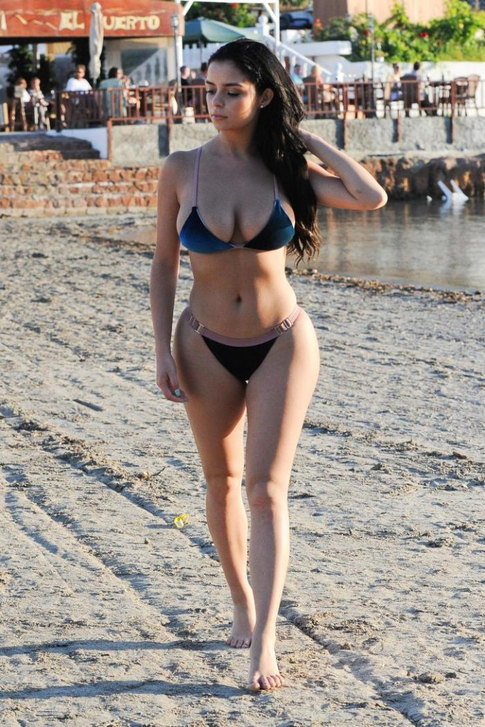 Demi Rose Mawby walking on the beach