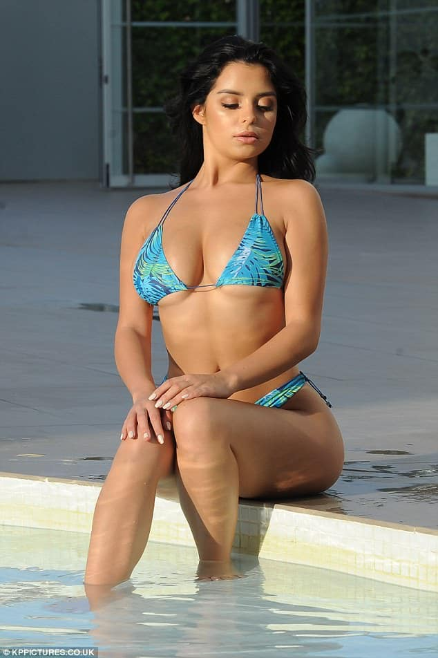 Demi Rose flaunting her body in bikini and looking down