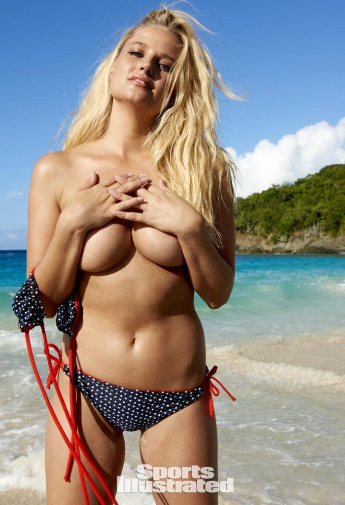 Genevieve Morton with hands over her topless chest