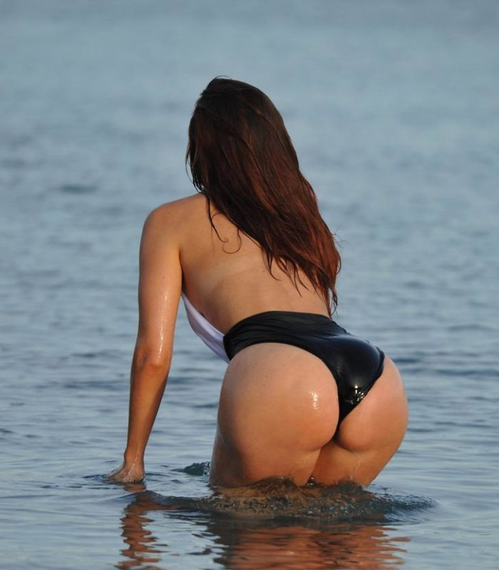 Jennifer Metcalfe bending over in the water and showing her ass cheeks
