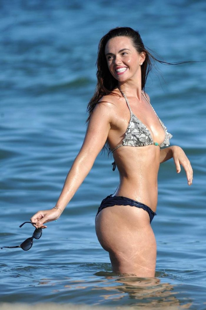 Jennifer Metcalfe in a black bottom thong at the beach